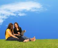 Girls Enjoying Laptop Outdoor Royalty Free Stock Photos