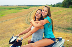 Girls enjoying motorcycle ride Stock Image