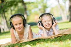 Girls enjoying music Stock Photos