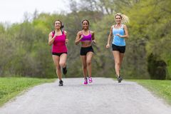 3 Girls Enjoying The Park On A Run Before Work royalty free stock images
