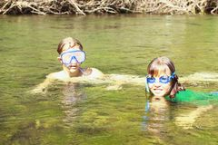 Girls enjoying the river water Royalty Free Stock Images