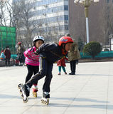Girls enjoying roller skating in park. Two girls enjoying roller skating  in park photoed in xigu park Tianjin China on March 9th 2014 Stock Photos
