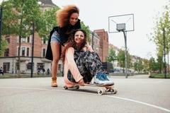 Girls enjoying skating outdoors Stock Photo