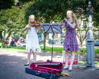 Girls entertain visitors in Esplanade Park in Helsinki Stock Photo