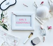 Girls essentials. High angle shot of women stuff lying against white background stock images