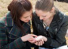 Girls examine lines on a palm Royalty Free Stock Photo