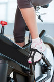Girls on exercise bikes. Stock Photos