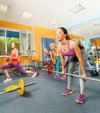 Girls exercising with barbell and weights Royalty Free Stock Photography