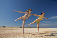 Girls exercising on a beach Stock Photo