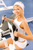 Girls exercising in gym Stock Images