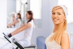 Girls exercising in gym Stock Photos