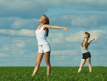 Girls exercising outdoors Stock Photo