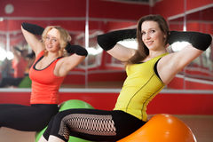Girls exercising on pilates balls Royalty Free Stock Image