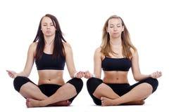 Girls exercising yoga Royalty Free Stock Photo