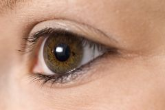 Girls eye. A close up macro photograph of a girls eye Royalty Free Stock Images