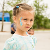 Girls With Face Painting. Cute young girl with face painting on her cheek stock photos