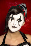 Girls face in  Pierrot Clown makup. Royalty Free Stock Images
