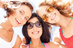Girls faces with shades looking down. Summer holidays and vacation - girls faces with shades looking down Stock Images