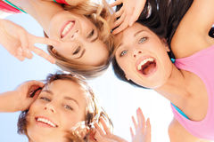 Girls faces with shades looking down. Summer holidays and vacation - girls faces with shades looking down Royalty Free Stock Image