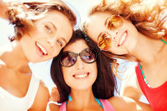 Girls faces with shades looking down. Summer holidays and vacation - girls faces with shades looking down Stock Image