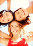 Girls faces with shades looking down Royalty Free Stock Photography