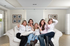 Girls in the family watching thriller Stock Images