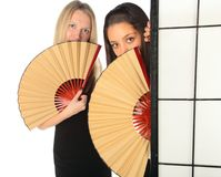 Girls with fan Stock Photo