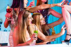 Girls with fancy cocktails in strip club. Drunk girls with fancy cocktails in strip club Stock Images