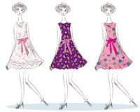 Girls in the fashion  dresses Stock Image