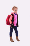 Girls, fashionably dressed with school bag on the back. Royalty Free Stock Image