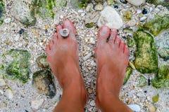 Girls feet on a beach, Boracay Island, Philippines Stock Images