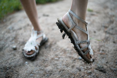 Girls feet in dirty sandals Royalty Free Stock Image