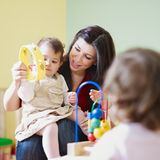 Girls and female teacher in kindergarten Royalty Free Stock Photo