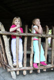 Girls on Fence Royalty Free Stock Photos