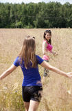 Girls on a field of grain Stock Photo