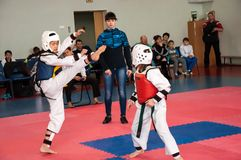 Girls fight in taekwondo Stock Photo