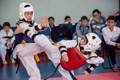 Girls fight in taekwondo Royalty Free Stock Photo