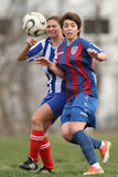 Girls fighting for ball during soccer game Royalty Free Stock Photography