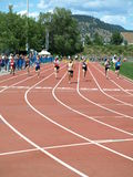 Girls on finish 100 meters dash. KELOWNA, CANADA - Clarke Shania, Griffin Robyn, Gilbert Tyra, Carrothers Katie,  Wilkes Maya,Dietrich,Geary Caitlin,Frenkel Royalty Free Stock Photo