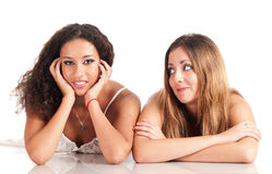 Girls firends diversity lying down Stock Photography