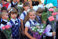 Girls first graders on a solemn ruler on September 1 Stock Image