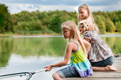 The girls are fishing Stock Photography
