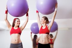 Girls with fitballs Stock Images