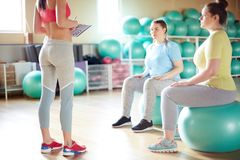 Girls on fitballs royalty free stock images