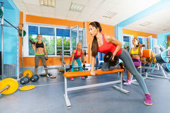 Girls in the fitness club lifting dumbbells Royalty Free Stock Photos