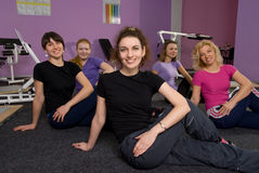 Girls in the fitness room Stock Photos