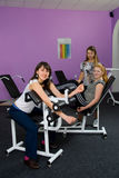Girls in the fitness room Stock Photo