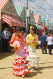 Girls in flamenco dresses at the Seville Fair. Stock Photos