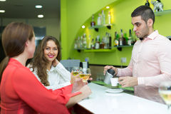 Girls flirting with barman Stock Photography
