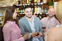 Girls flirting with men in a bar Stock Images